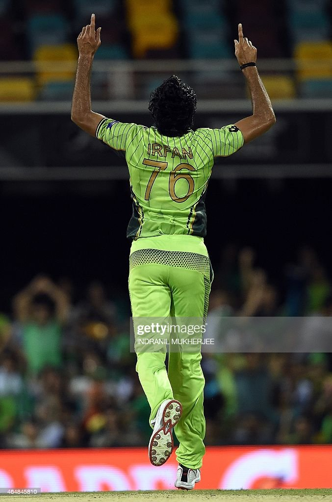 Pakistan bowler <a gi-track='captionPersonalityLinkClicked' href=/galleries/search?phrase=Mohammad+Irfan+-+Cricket+Player&family=editorial&specificpeople=10986295 ng-click='$event.stopPropagation()'>Mohammad Irfan</a> reacts after getting the wicket of Zimbabwe batsman Solomon Mire during the 2015 Cricket World Cup Pool B match between Pakistan and Zimbabwe at the Gabba Stadium in Brisbane on March 1, 2015. AFP PHOTO / INDRANIL MUKHERJEE -- IMAGE RESTRICTED TO EDITORIAL USE - STRICTLY NO COMMERCIAL USE--