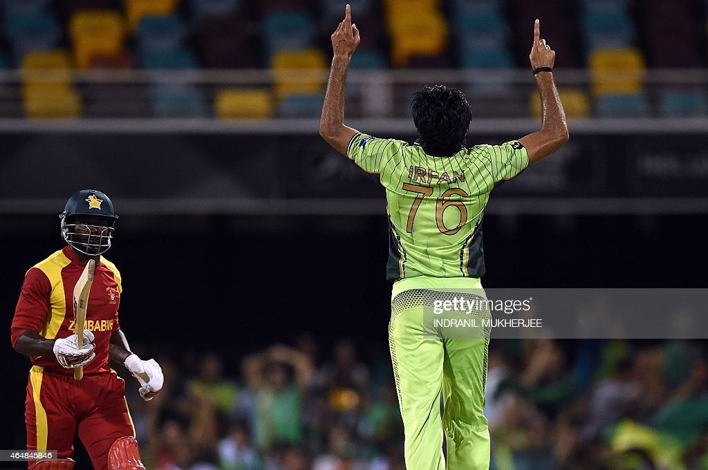 Pakistan bowler <a gi-track='captionPersonalityLinkClicked' href=/galleries/search?phrase=Mohammad+Irfan+-+Cricket+Player&family=editorial&specificpeople=10986295 ng-click='$event.stopPropagation()'>Mohammad Irfan</a> (C) reacts after getting the wicket of Zimbabwe batsman Solomon Mire during the 2015 Cricket World Cup Pool B match between Pakistan and Zimbabwe at the Gabba Stadium in Brisbane on March 1, 2015.