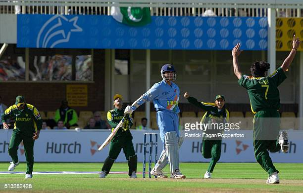 Pakistan bowler Mohammad Sami celebrates as Sourav Ganguly of India is out caught behind by Moin Khan of Pakistan during the ICC Champions Trophy...