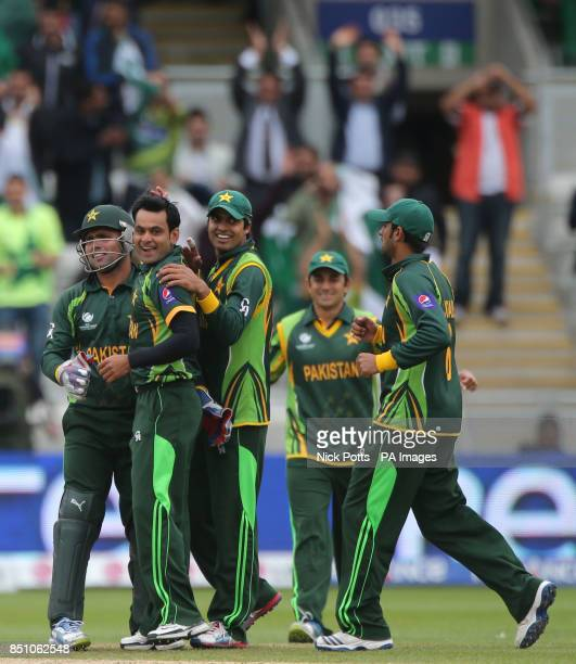 Pakistan bowler Muhammad Hafeez celebrates with wicketkeeper Kamran Akmal after trapping South Africa opening batsman Colin Ingram LBW during the ICC...