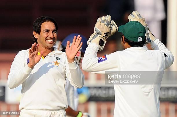 Pakistan bowler Saeed Ajma celebrates dismissing unseen Sri Lankan batsman Mahela Jayawardene during the opening day of the third and final cricket...