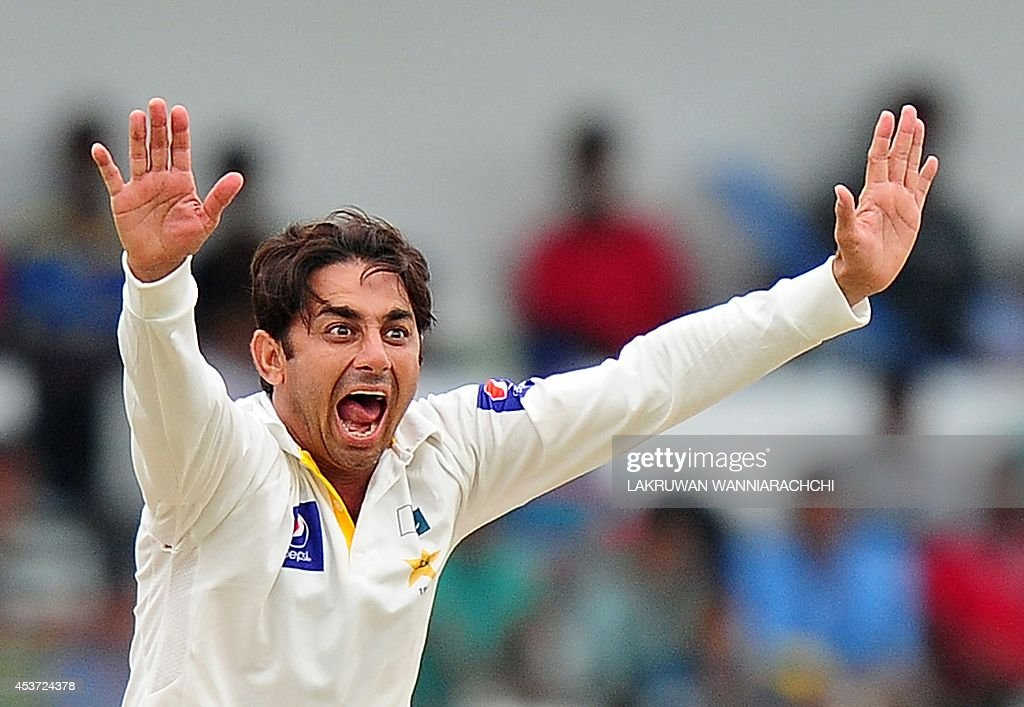 Pakistan bowler Saeed Ajmal successfully appeals for the wicket of Sri Lankan batsman Dhammika Prasad during the fourth day of the second Test match between Sri Lanka and Pakistan at the Sinhalese Sports Club (SSC) Ground in Colombo on August 17, 2014. AFP PHOTO/ LAKRUWAN WANNIARACHCHI