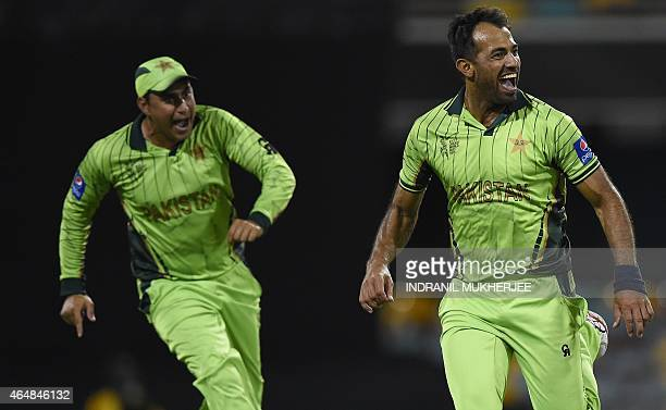 Pakistan bowler Wahab Riaz and Nasir Jamshed react after getting the wicket of Zimbabwe batsman Tawanda Mupariwa during the 2015 Cricket World Cup...