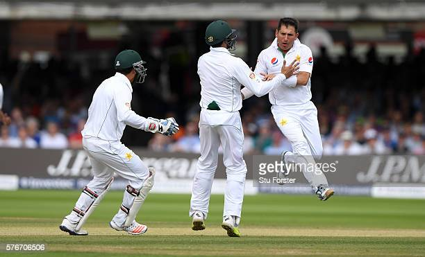 Pakistan bowler Yasir Shah is congratulated by team mates after bowling England batsman Gary Ballance during day four of the 1st Investec Test match...
