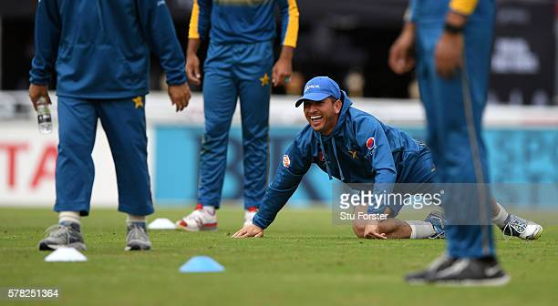 Pakistan bowler Yasir Shah shares a joke with team mates during Pakistan Nets ahead of the 2nd Investec test match against England at Old Trafford on...