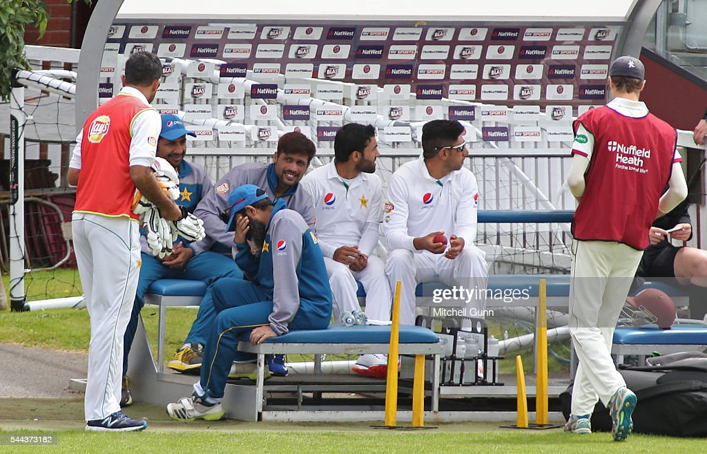 Pakistan bowling Mushtaq Ahmed coach reacts as the players on the bench share a joke during the tour match between Somerset and Pakistan at The...