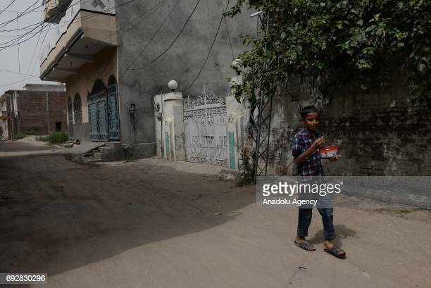 Pakistan boy walks past in front of the native house of Khuram Shazad Butt one of the three attackers of the London terror attack in his hometown in...