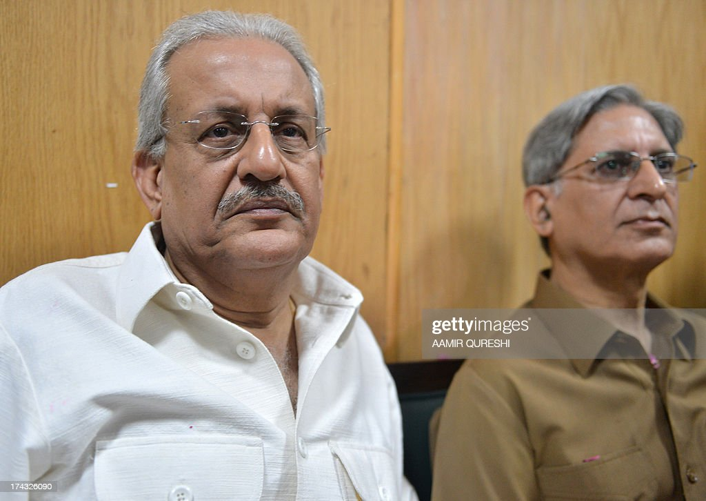 Pakistan candidate for the upcoming presidential election of opposition Pakistan People's Party (PPP) Senator Raza Rabbani (L), waits to submits his nomination paper at the High Court in Islamabad on July 24, 2013. Pakistan's Supreme Court on July 24 revised the date for the presidential election, asking the election commission to hold it on July 30 instead of August 6. The court made the order as many of the lawmakers who will elect a replacement for President Asif Ali Zardari will be paying pilgrimages or offering special prayers on August 6 for the Islamic holy month of Ramadan, which ends a few days later.
