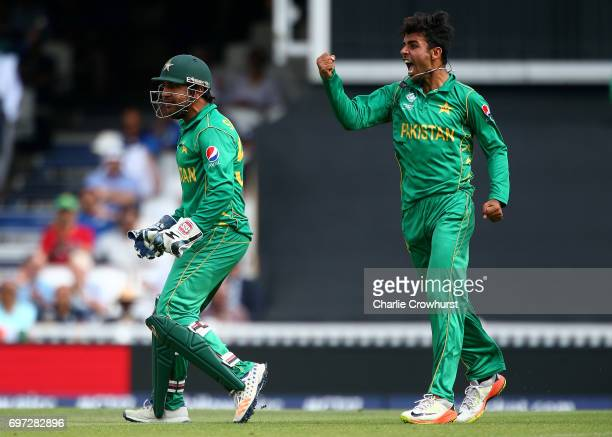 Pakistan captain and wicket keeper Sarfraz Ahmed celebrates after taking catching out India's Kedar Jadhav off of the bowling of Shadab Khan during...
