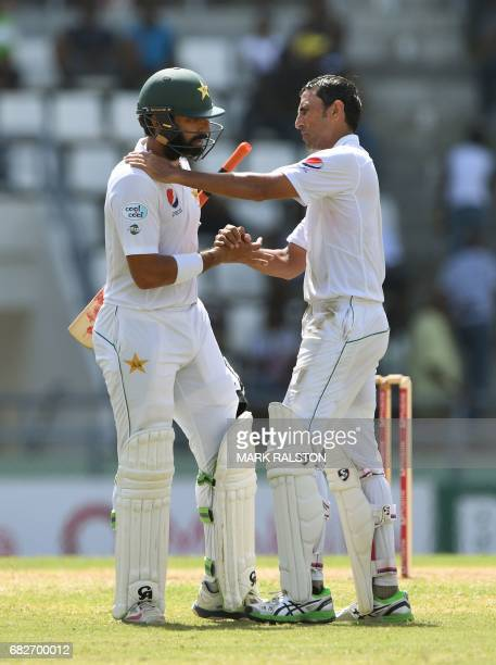 Pakistan captain MisbahulHaq is consoled by teammate and fellow retiree Younis Khan after he was dismissed for 2 when batting for the last time...