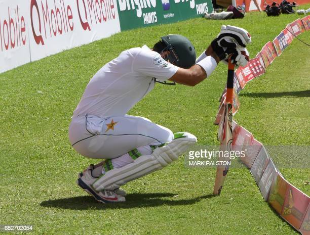 Pakistan captain MisbahulHaq kneels to pray as he heads out to bat for the last time before retirement on the fourth days play of the final test...