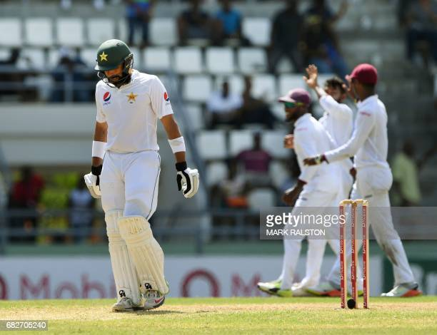 Pakistan captain MisbahulHaq leaves the field for the last time before his retirement on the fourth days play of the final test match against the...