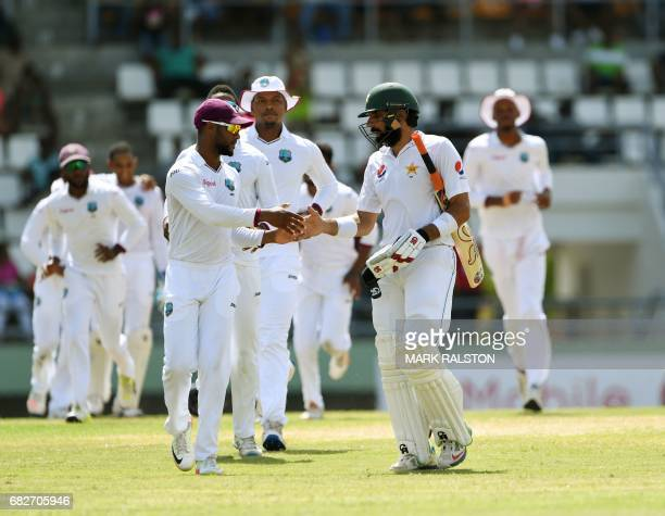 Pakistan captain MisbahulHaq shakes hands with members of the West Indies team as he leaves the field for the last time before his retirement on the...