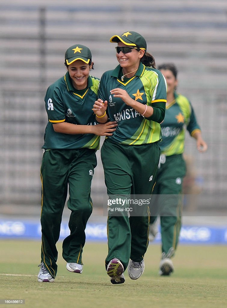 Pakistan captain Sana Mir celebrates a wicket with teammate Javeria Khan during the second match of ICC Womens World Cup between Australia and Pakistan, played at the Barabati stadium on February 1, 2013 in Cuttack, India.