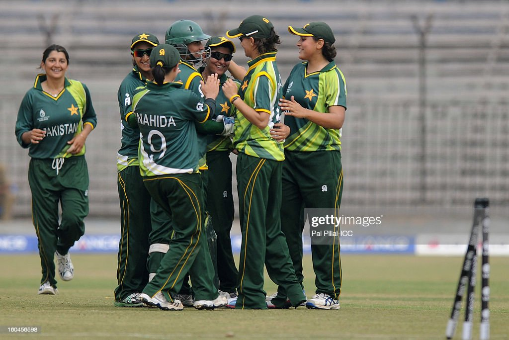 Pakistan captain Sana Mir celebrates a wicket with teammates during the second match of ICC Womens World Cup between Australia and Pakistan, played at the Barabati stadium on February 1, 2013 in Cuttack, India.