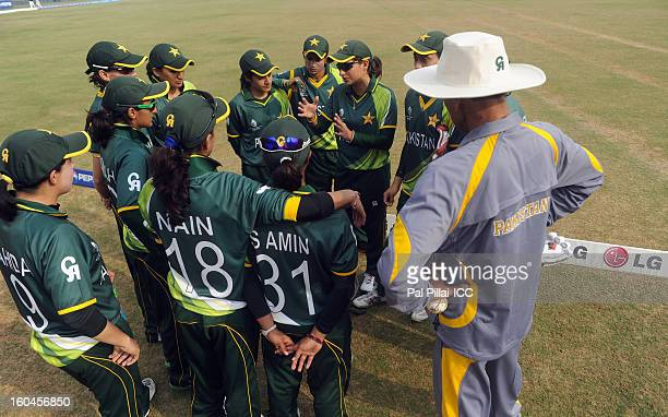 Pakistan captain Sana Mir speaks to teammates before the start of the second match of ICC Womens World Cup between Australia and Pakistan played at...