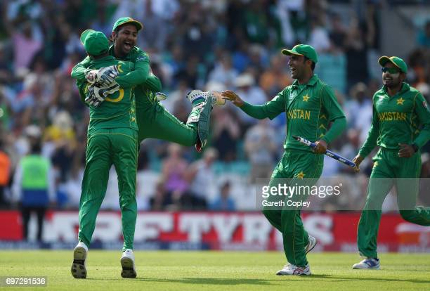 Pakistan captain Sarfraz Ahmed celebrates with Shoaib Malik after winning the ICC Champions Trophy Final between India and Pakistan at The Kia Oval...