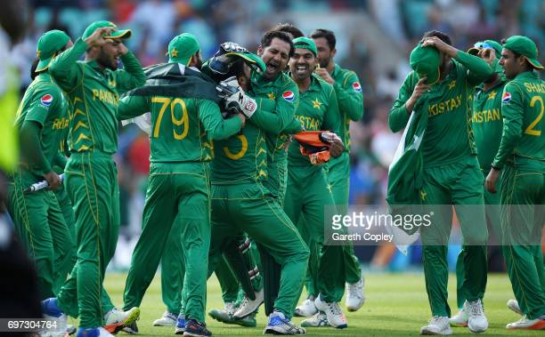 Pakistan captain Sarfraz Ahmed celebrates with teammates after winning the ICC Champions Trophy Final between India and Pakistan at The Kia Oval on...