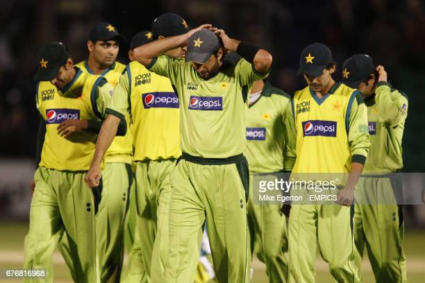 Pakistan captain Shahid Afridi leads his team off the pitch after defeat