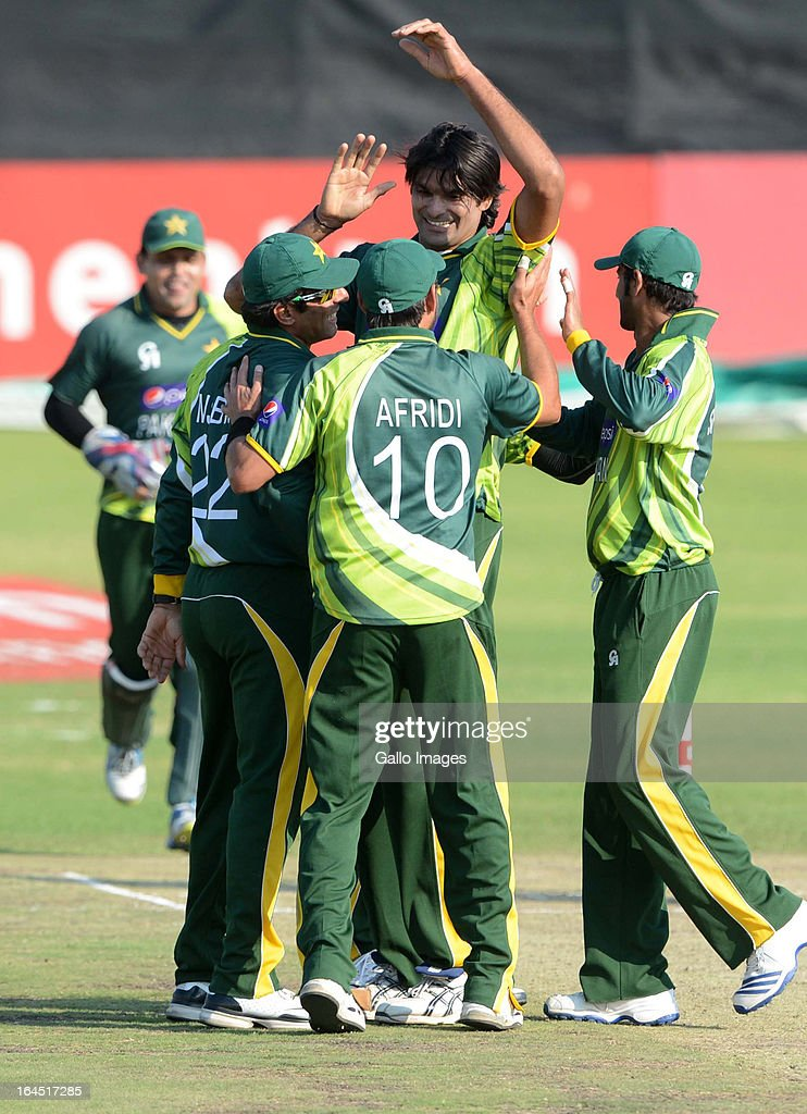 Pakistan celebrate the wicket of Hashim Amla of South Africa during the 5th Momentum ODI match between South Africa and Pakistan from Willowmoore Park on March 24, 2013 in Benoni, South Africa.
