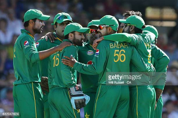 Pakistan celebrates after taking the wicket of David Warner of Australia during game three of the One Day International series between Australia and...