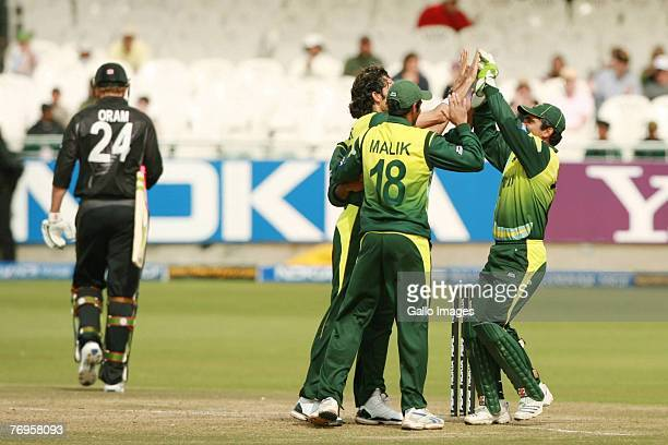 Pakistan celebrates the wicket of Jacob Oram during the Twenty20 Cup Semi Final match between New Zealand and Pakistan at Newlands Cricket Ground on...