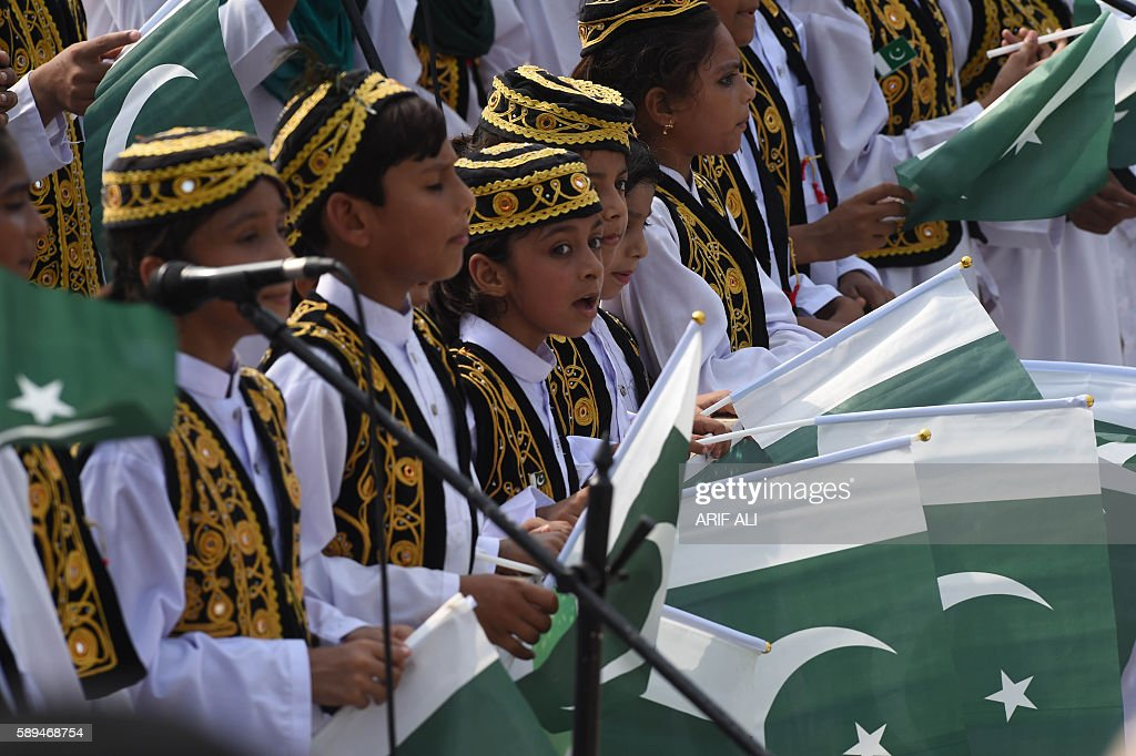 Pakistan children sing national songs during the ceremony to celebrate Pakistan's Independence Day at the PakistanIndia Wagah border post on August...