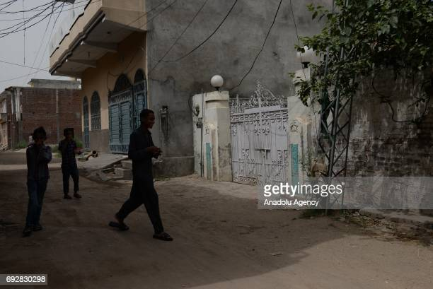 Pakistan children walk past in front of the native house of Khuram Shazad Butt one of the three attackers of the London terror attack in his hometown...