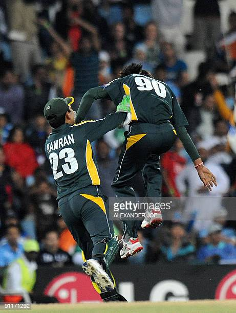 Pakistan circketer Mohammad Aamir celebrates after his dismissal of unseen Indian cricketer Yusuf Pathan during The ICC Champions Trophy match...