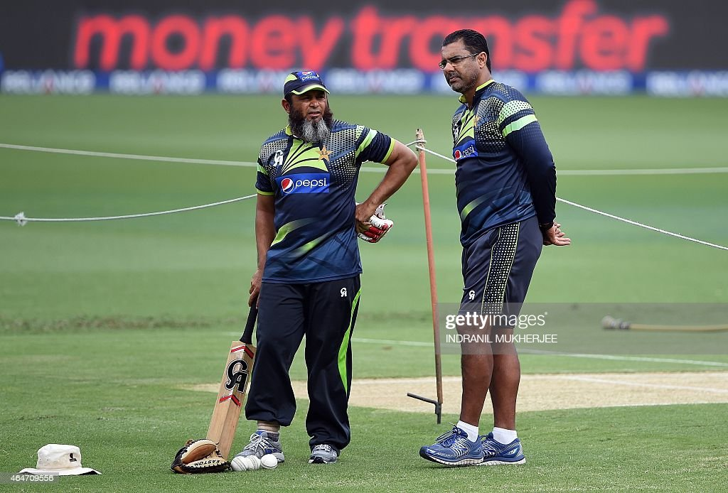 Pakistan coaches Mushtaq Ahmed and Waqar Younis look on during their training session ahead of the 2015 Cricket World Cup Pool B match between...
