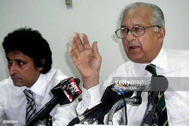 Pakistan Cricket Board Chairman Shaharyar Khan gestures during a press conference as PCB chief executive Ramiz Raja listens in Karachi 16 June 2004...