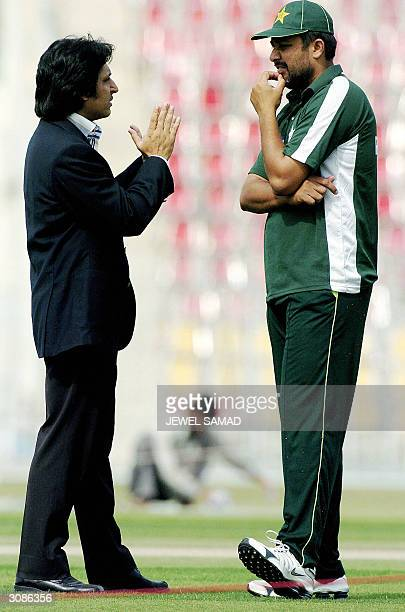 Pakistan Cricket Board Chief Executive Ramiz Raja and Pakistani captain Inzamamul Haq chat together at the Pindi stadium in Rawalpindi 15 March 2004...