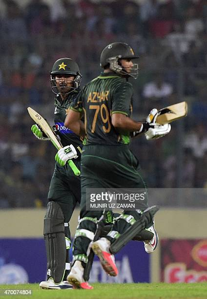 Pakistan cricket captain Azhar Ali run between the wickets with teammate Haris Sohail during the first One Day International cricket match between...