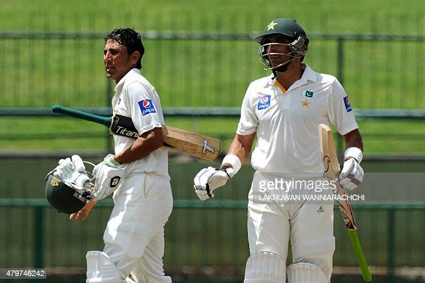 Pakistan cricket captain MisbahulHaq celebrates with teammate Younis Khan after their team's series victory in the third and final Test cricket match...