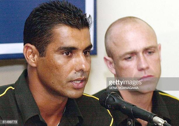 Pakistan cricket captain Waqar Younis speaks as coach Richard Pybus looks on during a press conference 01 October 2002 ahead of the first Test...