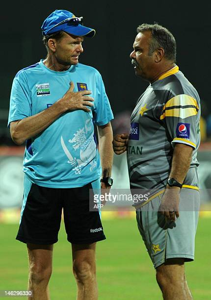 Pakistan cricket coach Dave Whatmore chats with Sri Lanka cricket coach Graham Ford as rain stops play during the third oneday international match...