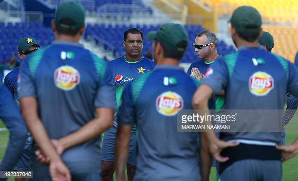 Pakistan cricket coach Waqar Younis speaks with his players during a training session at the Sheikh Zayed Cricket Stadium in Abu Dhabi on October 12...
