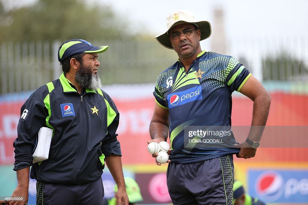 Pakistan cricket coach Waqar Yuonis and Mushtaq Ahmed attend a team training session ahead of their 2015 Cricket World Cup match against South Africa...