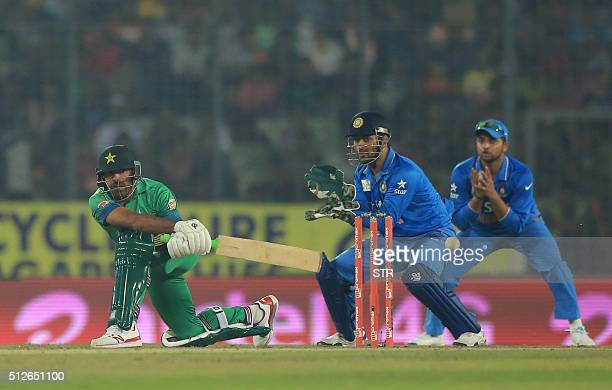 Pakistan cricket player Wahab Riaz plays a shot during the match between India and Pakistan at the Asia Cup T20 cricket tournament at the ShereBangla...