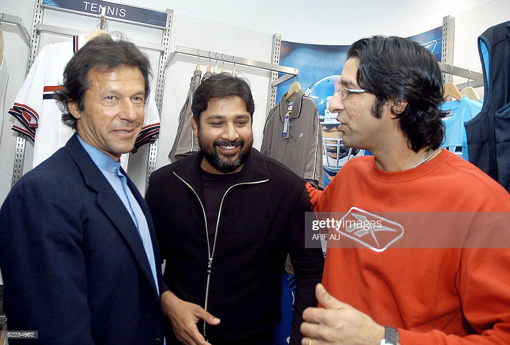 Pakistan cricket team captain Inzamamul Haq smiles standing in middle of former cricket heroes Imran Khan and Wasim Akram during the opening of...