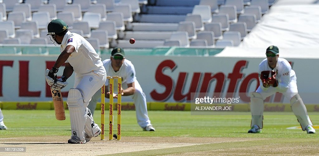 Pakistan cricketer Asad Shafiq looks back as he was caught out on 111 runs bowled by unseen South African cricketer Vernon Philander on day two of the 2nd Test between South Africa and Pakistan, at Newlands in Cape Town on February 15, 2013. AFP PHOTO / ALEXANDER JOE