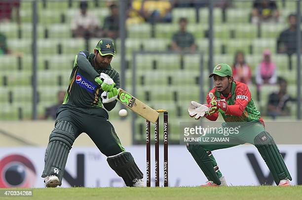 Pakistan cricketer Haris Sohail plays a shot as Bangladesh wicketkeeper Mushfiqur Rahim looks on during the second One Day International cricket...