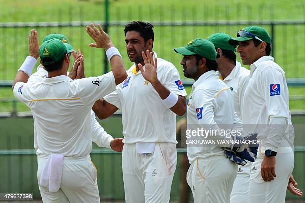 Pakistan cricketer Imran Khan celebrates with his teammates after he dismissed Sri Lankan cricketer Dhammika Prasad during the fourth day of the...