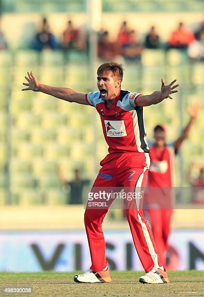 Pakistan cricketer Mohammad Amir appeals successfully for a leg before wicket decision during the Bangladesh Premier League Twenty20 cricket match...