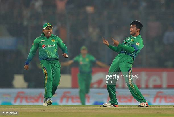 Pakistan cricketer Mohammad Amir successfully appeals for a Leg Before Wicket decision against Indian cricketer Suresh Raina during the match between...