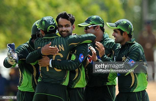Pakistan cricketer Mohammad Hafeez celebrates with teammates after he dismissed unseen Sri Lankan batsman Kusal Perera during the first one day...
