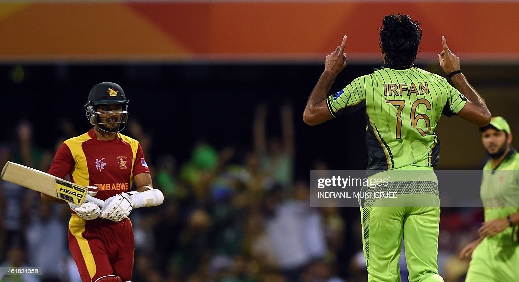 Pakistan cricketer <a gi-track='captionPersonalityLinkClicked' href=/galleries/search?phrase=Mohammad+Irfan+-+Cricket+Player&family=editorial&specificpeople=10986295 ng-click='$event.stopPropagation()'>Mohammad Irfan</a> reacts after taking the wicket of Zimbabwe batsman Sikandar Raza (L) as teammate Shihd Afridi (R) looks on during the 2015 Cricket World Cup Pool B match between Pakistan and Zimbabwe at the Gabba Stadium in Brisbane on March 1, 2015. AFP PHOTO / INDRANIL MUKHERJEE USE--