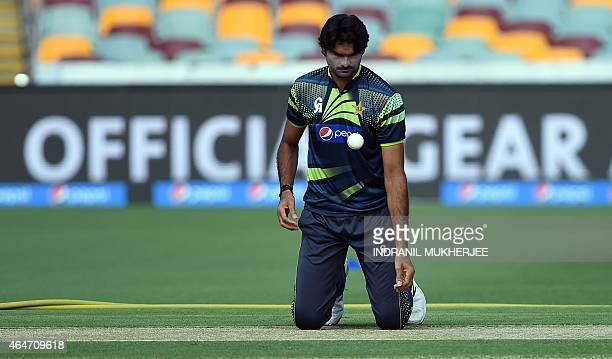 Pakistan cricketer Mohammad Irfan tests the bounce of the pitch during their training session ahead of the 2015 Cricket World Cup Pool B match...