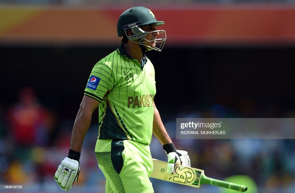 Pakistan cricketer <a gi-track='captionPersonalityLinkClicked' href=/galleries/search?phrase=Nasir+Jamshed&family=editorial&specificpeople=4819500 ng-click='$event.stopPropagation()'>Nasir Jamshed</a> walks back after being dismissed by Zimbabwe during the 2015 Cricket World Cup Pool B match between Pakistan and Zimbabwe at the Gabba Stadium in Brisbane on March 1, 2015.