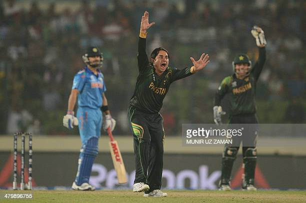 Pakistan cricketer Saeed Ajmal unsuccessfully appeals for a leg before wicket decision against Indian cricketer Virat Kohli during the ICC World...